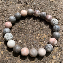 Load image into Gallery viewer, Pink Zebra Jasper essential oil diffuser bracelet with two lava rocks