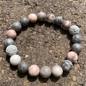 Pink Zebra Jasper essential oil diffuser bracelet with two lava rocks