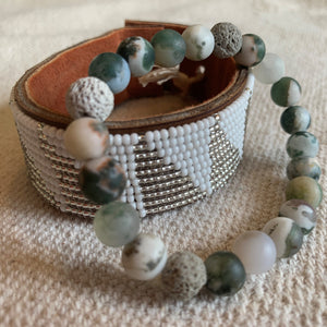 Fair trade Medium Silver & White Triangle African Hand-beaded Leather Cuff worn with green agate bracelet