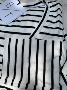 Long sleeve white and black striped soft knit shirt closeup of fabric