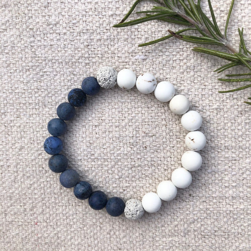 Bracelet made of half dumortierite beads, half magnesite beads, and two natural lava rocks.
