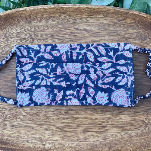 Fair trade ethically made cloth face mask with blue, white and fushsia floral pattern made by hand block printing.