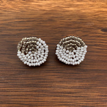 Load image into Gallery viewer, Fair trade and ethical ¾ inch diameter hand beaded suede backed stud earring, white beads with a silver wedge design.