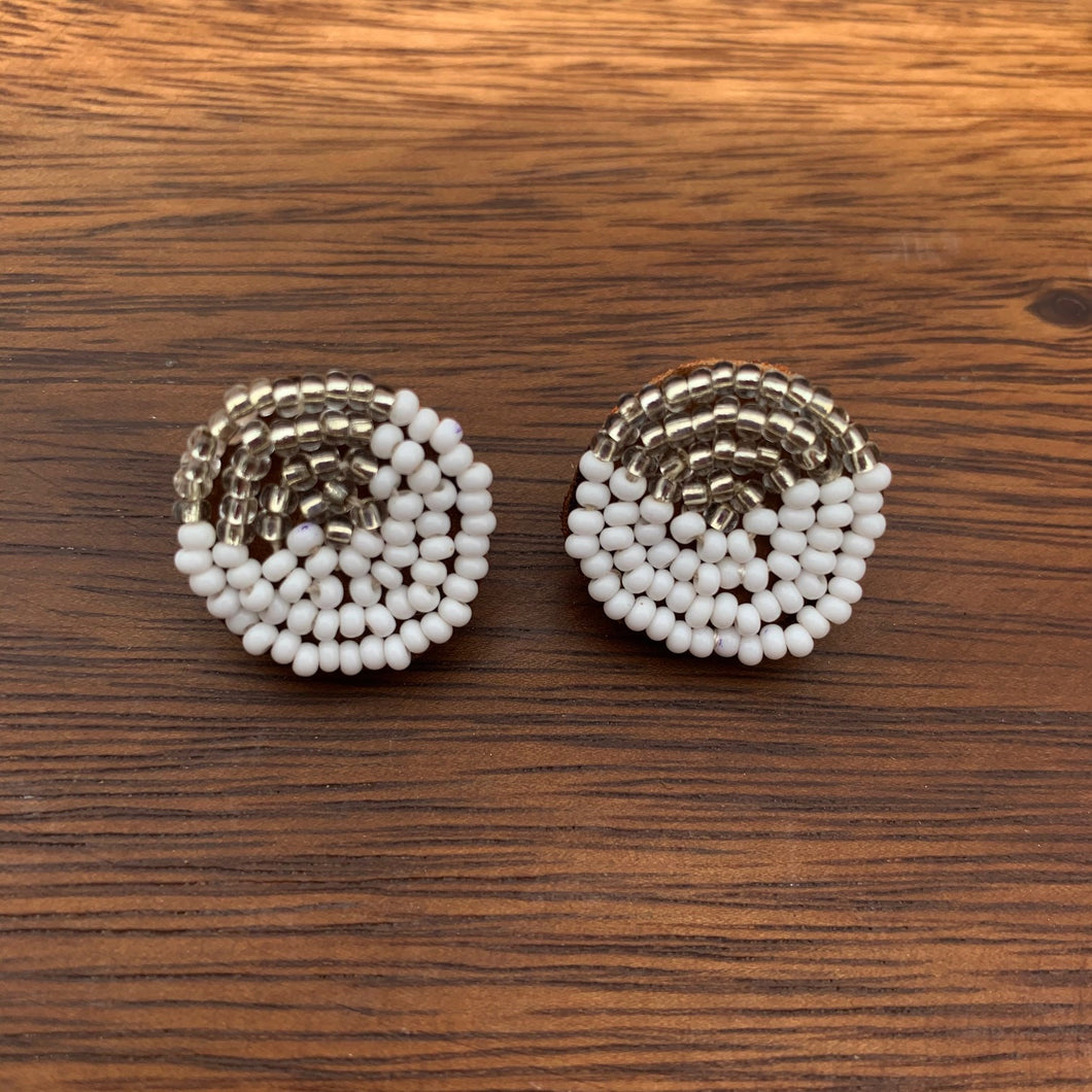 Fair trade and ethical ¾ inch diameter hand beaded suede backed stud earring, white beads with a silver wedge design.