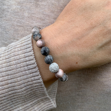 Load image into Gallery viewer, Pink Zebra Jasper essential oil diffuser bracelet with two lava rocks on wrist