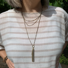 Load image into Gallery viewer, Ombre metallic tiny glass bead tassel necklace shown being worn