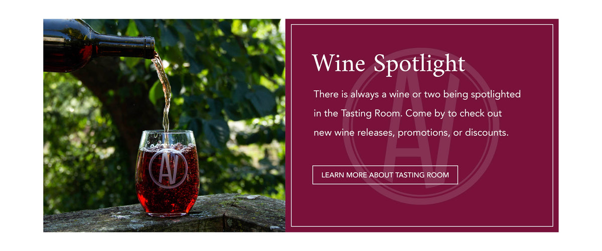 "Pouring wine into an AV branded wine glass. Text next to image reads, ""There is always a wine or two being spotlighted in the Tasting Room. Come by to check out new wine releases, promotions, or discounts."""