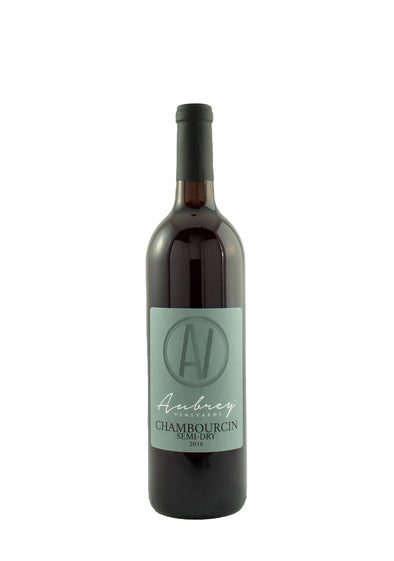 A bottle of Aubrey Vineyards 2016 Chambourcin Semi-Dry on a white background.