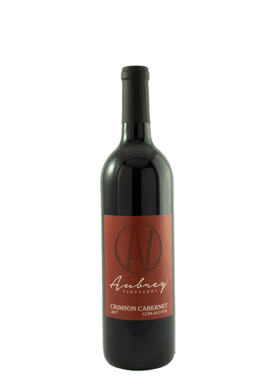 A bottle of Aubrey Vineyards 2017 Crimson Cabernet on a white background.