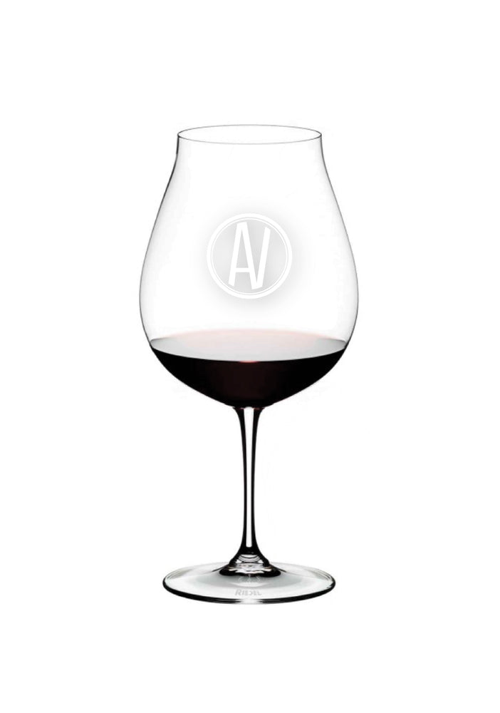Riedel Wine Glass etched with Aubrey Vineyards circle logo on one side and the Aubrey script logo on the other side.