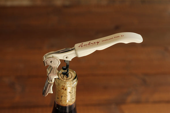 A close up on a white Aubrey Vineyards corkscrew.