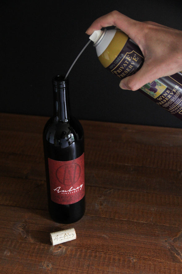 A can of Private Preserve being used to preserve an open bottle of Aubrey Vineyards Crimson Cabernet.
