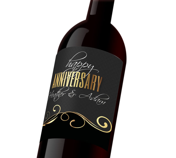 "Black and gold custom wine label with white and gold text that reads, ""Happy Anniversary Heather & Adam"""