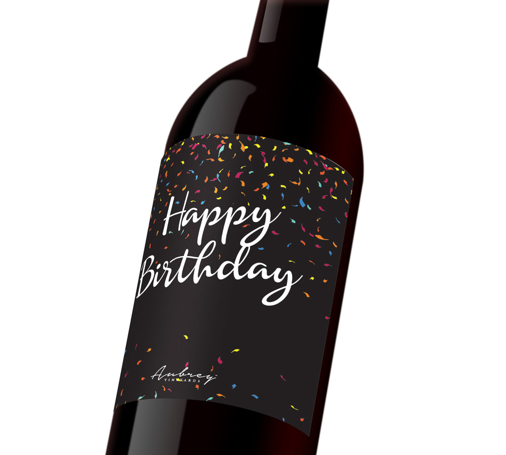 "A black custom wine label with colorful confetti that reads, ""Happy Birthday""."