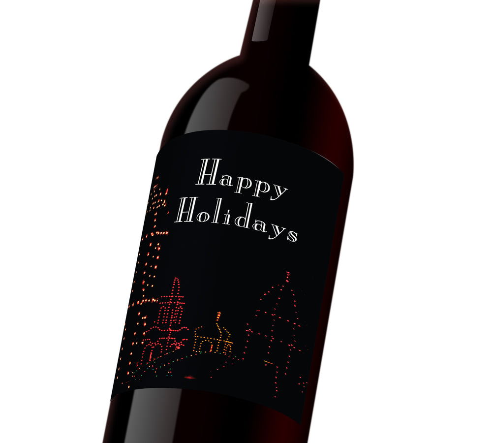 "A black holiday custom wine label with the plaza outlined in holiday lights. The label reads, ""Happy Holidays"""