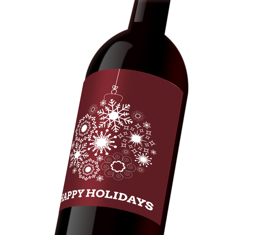 "A maroon holiday custom label depicting a white holiday ornament made out of snowflakes. The label reads, ""Happy Holidays"""