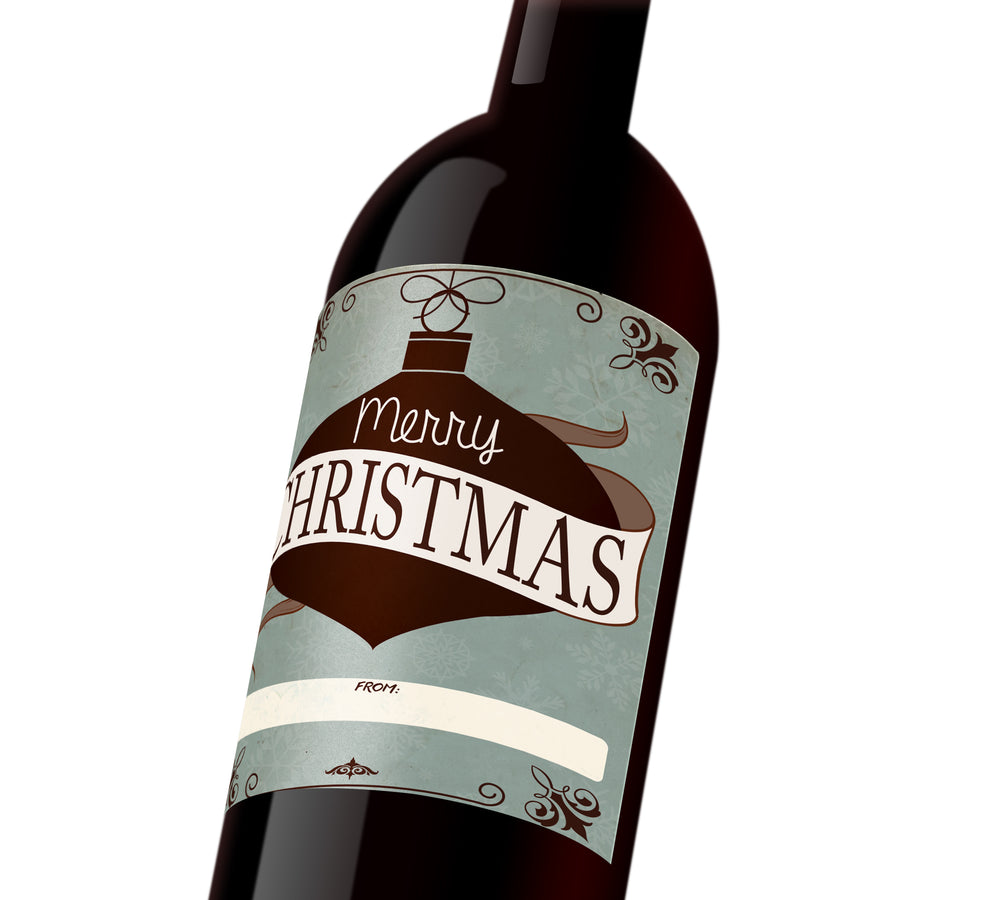 "Blue custom wine label with a brown holiday ornament that reads, ""Merry Christmas"" with a ""to"" and ""from"" banner at the bottom."