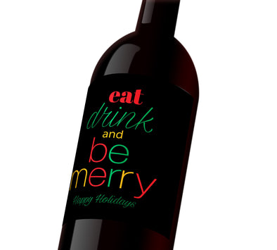 "A black holiday wine label with red, green, and yellow text that reads, ""Eat, drink, and be merry. Happy Holidays"""