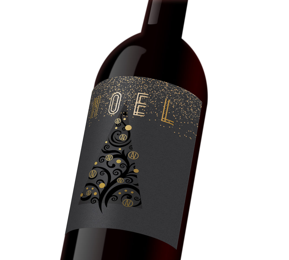 "A black and gold holiday custom wine label that reads, ""Noel""."