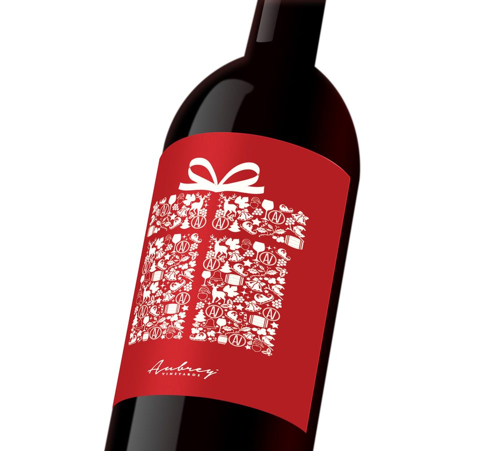 A red holiday custom wine label depicting a white present.