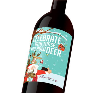 "A blue comical holiday custom label depicting Santa taking a selfie with his reindeer. The label reads, ""Celebrate with those you hold deer""."