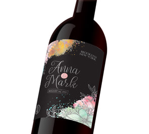 "A black customizable label with colorful floral embellishment. The label reads, ""Anna & Mark August 16, 2017 Brooklyn, New York"""