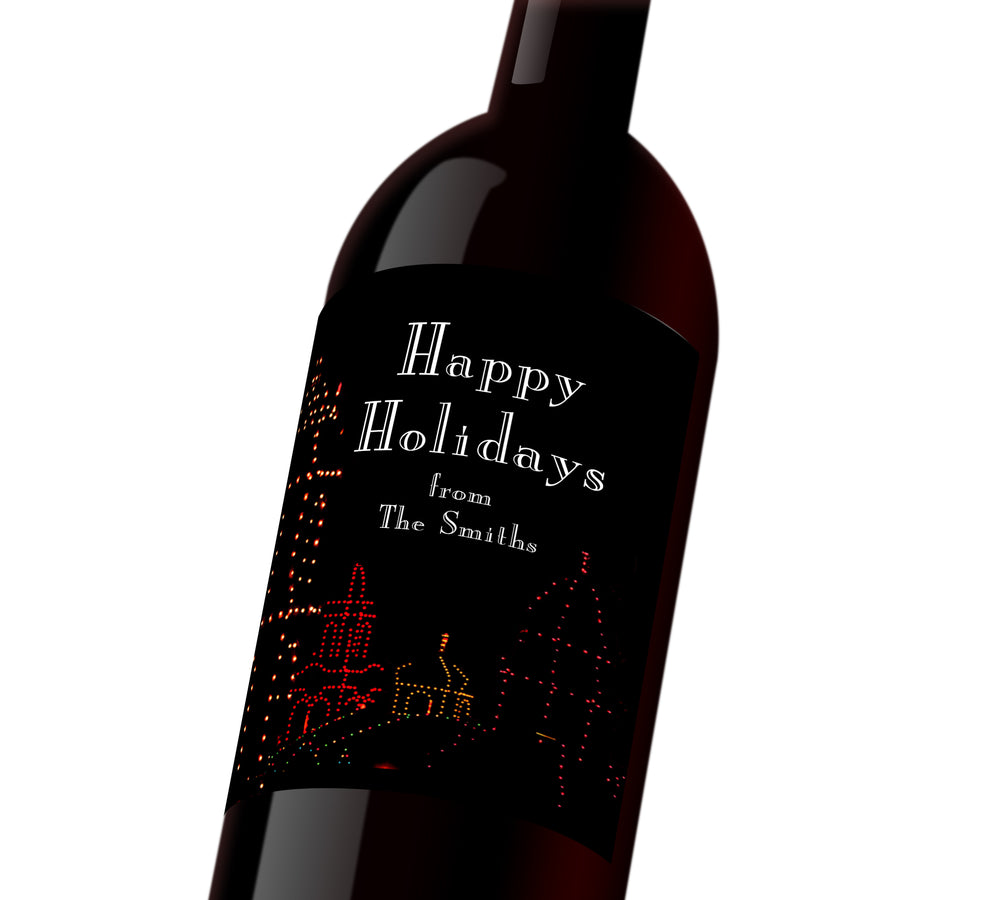 A black holiday customizable wine label with the plaza outlined in holiday lights. The label reads,