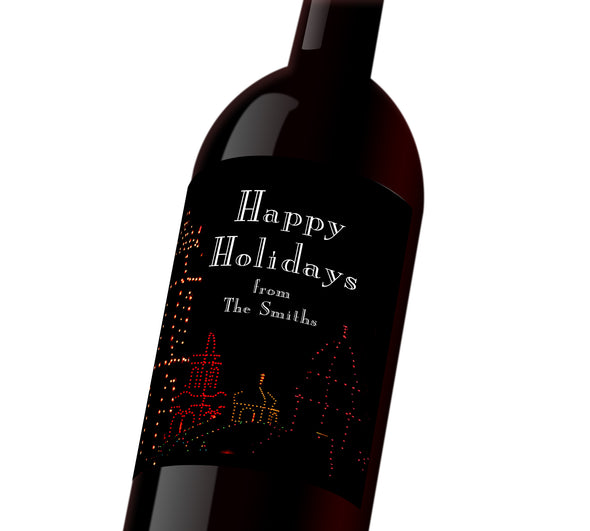 "A black holiday customizable wine label with the plaza outlined in holiday lights. The label reads, ""Happy Holidays from The Smiths"""