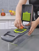 Load and play video in Gallery viewer, Best Kitchen Gadget Ever!  Cutter Grater Slicer Peeler and more!