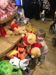 Young girl with stuffed animals