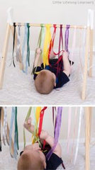 Baby playing with ribbons