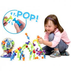 Fat Brain Toys Squigz Starter Set girl playing with