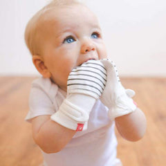Baby wearing Goumikids mitts