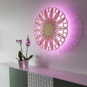 Open image in slideshow, KuvaLight Anemoon out of Bamboo in a office setting. The pink color of the light fits the orchids on the filing cabinets hanging on the wall.