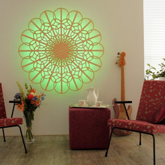 KuvaLight Braga in Bamboo with a spring green light in a teatime setting with Gispen chairs and a guitar.