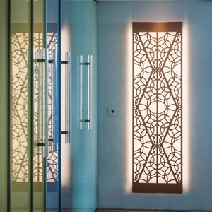 KuvaLight Minho 2  in brushed copper with warm white light hanging vertically in a hallway.