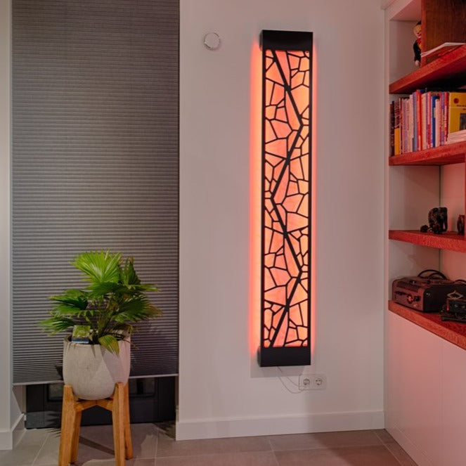 KuvaLight Mosaic design lamp in Piano Black with a orange light in a evening home setting.