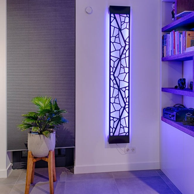 KuvaLight Mosaic design lamp in Piano Black with a blue light in a evening home setting.