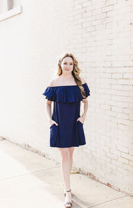 "This trendy off shoulder dress has double ruffle with side pockets and is great for everyday dress. Stylish, yet incredibly comfortable.  Details - Off shoulder solid jersey dress - Ruffled top - Double layered ruffle sleeve - Side pockets - Easy to wear  Size + Fit - Model is 5'9"" and wearing size small  • 95% RAYON 5% SPANDEX"