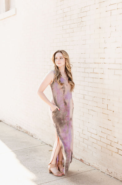Good vibes come with this drift away tie dye jersey maxi dress - It's a V-neck style sleeveless summer dress with side pockets that is full length a with side slit hem, made with french terry jersey.  The model is wearing a size small.