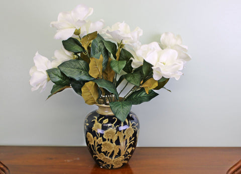 A high quality ceramic vase in a dark navy blue and stone flowered embossed design.  Part of our regal ceramic range, other items are available in this pattern. Top opening diameter 8.5cm. The product features protective pads on the underside to protect your furniture. Measurements: 18 x 25 x 18cm