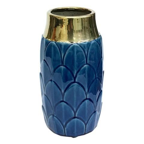 A stylish ceramic blue coloured vase with a decorative art deco inspired motif. This stunning vase embraces modern and traditional styles creating a luxury yet functional everyday home accessory - perfect for displaying fresh or dried flowers in any room in the home. The neck of the vase is finished in a shiny gold coloured glaze adding a glamorous touch that compliments the art deco design. Finished in a deep blue colour it will make a great finishing touch to the lounge, dining room or bedroom.