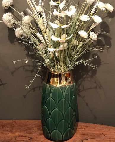 A stylish ceramic green coloured vase with a decorative art deco inspired motif. This stunning vase embraces modern and traditional styles creating a luxury yet functional everyday home accessory - perfect for displaying fresh or dried flowers in any room in the home. The neck of the vase is finished in a shiny gold coloured glaze adding a glamorous touch that compliments the art deco design. Finished in a green colour it will make a great finishing touch to the lounge, dining room or bedroom and makes ...