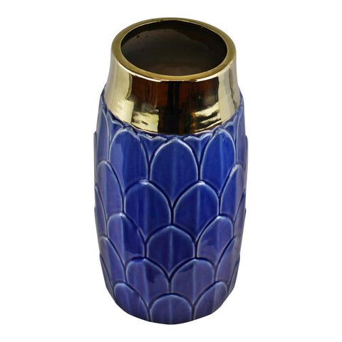 A stylish ceramic blue coloured vase with a decorative art deco inspired motif. This stunning vase embraces modern and traditional styles creating a luxury yet functional everyday home accessory - perfect for displaying fresh or dried flowers in any room in the home. The neck of the vase is finished in a shiny gold coloured glaze adding a glamorous touch that compliments the art deco design. Finished in a deep blue colour it will make a great finishing touch to the lounge, dining room or bedroom and mak..