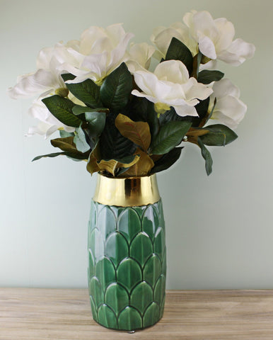 A stylish ceramic green coloured vase with a decorative art deco inspired motif. This stunning vase embraces modern and traditional styles creating a luxury yet functional everyday home accessory - perfect for displaying fresh or dried flowers in any room in the home. The neck of the vase is finished in a shiny gold coloured glaze adding a glamorous touch that compliments the art deco design. Finished in a deep green colour it will make a great finishing touch to the lounge, dining room or bedroom and m