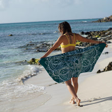 Load image into Gallery viewer, woman standing on shore with arms outstretched holding teal towel with mandala print