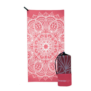 coral pink towel with large white mandala print, hang loop on upper left corner and branded pink carrying pouch