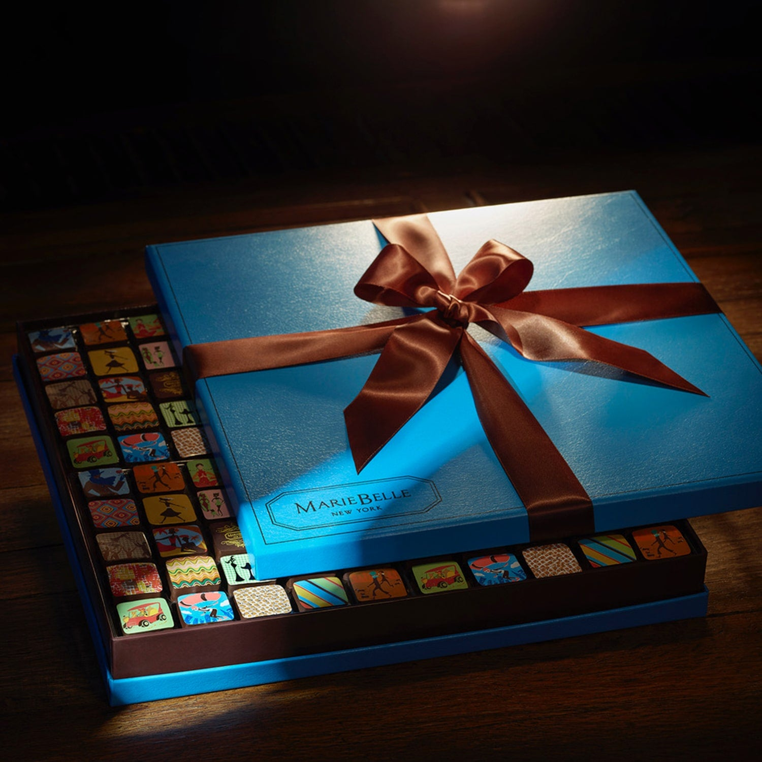 Signature ganache and truffles collection image featuring the signature 100pc Cien Ganache Blue Box.