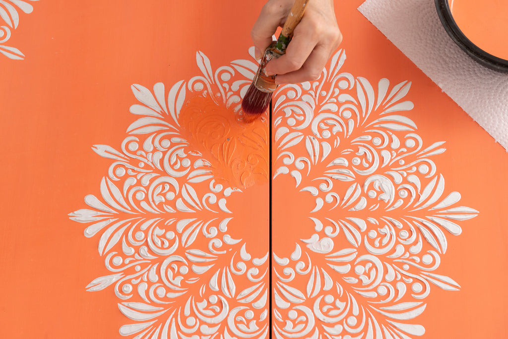 MDF Cabinet with raised stencilling painted in Aperol Spritz Milk Paint by Fusion