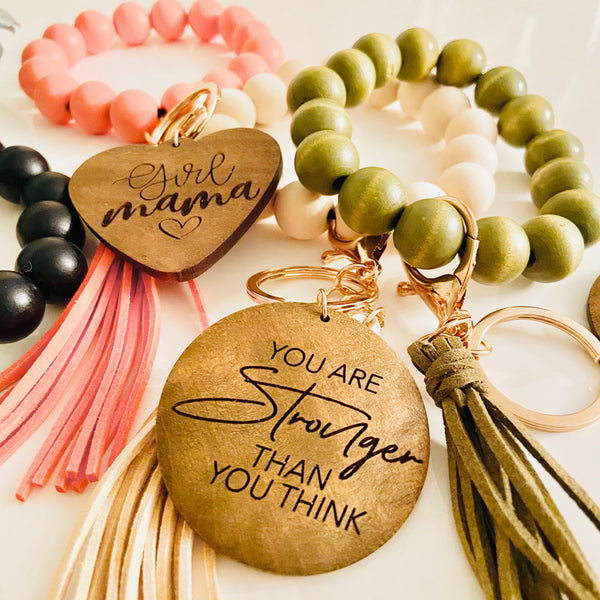 Wooden beads bracelets with engraved charm and tassel